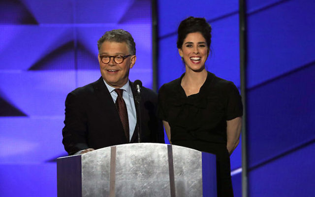 Sen. Al Franken and comedian Sarah Silverman sharing a microphone during the first day of the Democratic National Convention at the Wells Fargo Center in Philadelphia, July 25, 2016. (Alex Wong/Getty Images)