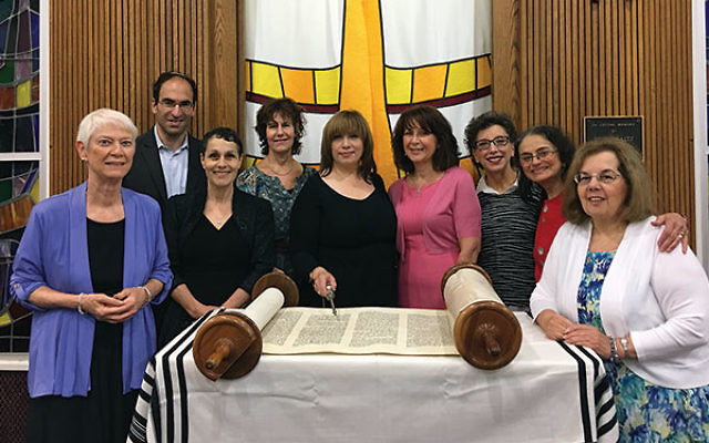 Rabbi Menashe East with members of Mount Freedom Jewish Center's first adult b'not mitzva class, from left, Madeleine Pasteelnick, Rabbi Menashe East, Marilyn Lampel, Audrey Silverberg, Darsi Beauchamp, Fay