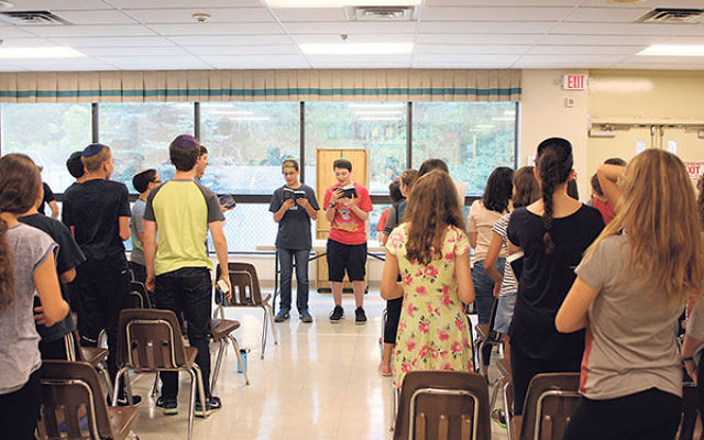 A prayer session for middle school students at Golda Och Academy, Sept. 9