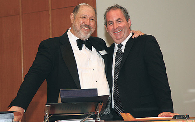 Honoree Cantor Stuart Binder, right, with Rabbi Eric Wisnia.