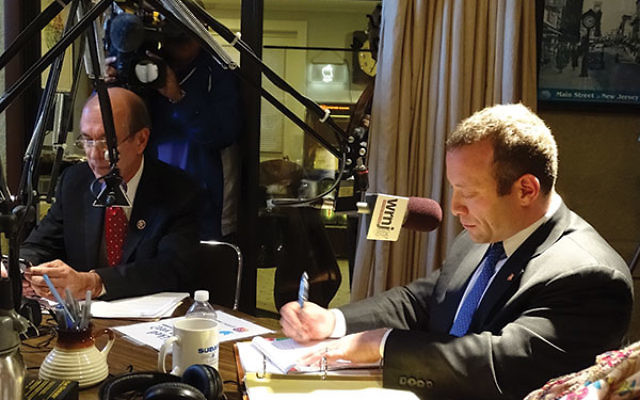 Rep. Scott Garrett (R-Dist. 5), left, and his Democratic challenger, Josh Gottheimer, appear for their one and only debate Oct. 31 at radio station WRNJ in Hackettstown.