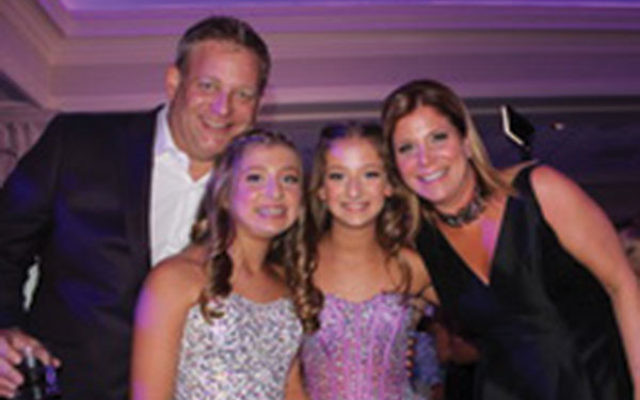 Emma Grunstein, third from left, with her sister, Aerin, and parents, Richard and Randi, at the twins' b'not mitzva celebration in September.