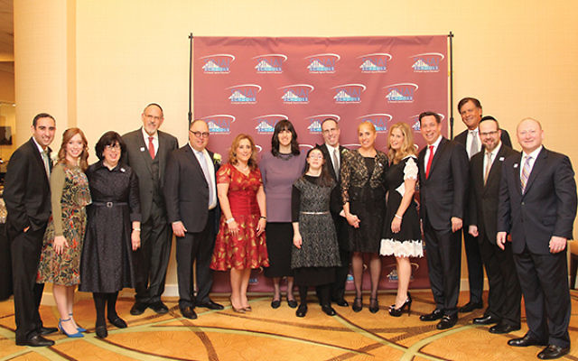 Honorees with staff and board members of the SINAI Schools. From left, Moshe and Orit Zharnest, Dean Emeritus Laurette Rothwachs, Chairman of the Board Rabbi Mark Karasick, Moshe and Esther Muschel, Malca and Rabbi Chaim Jachter with daughter Chaya Zipora