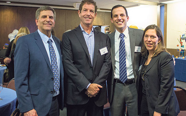 Jeffrey Landau, immediate past chair of the GOA board of trustees, left, joins former student and school benefactor Daniel Och, head of school Adam Shapiro, and current board chair Atara Jacobson, class of '87.