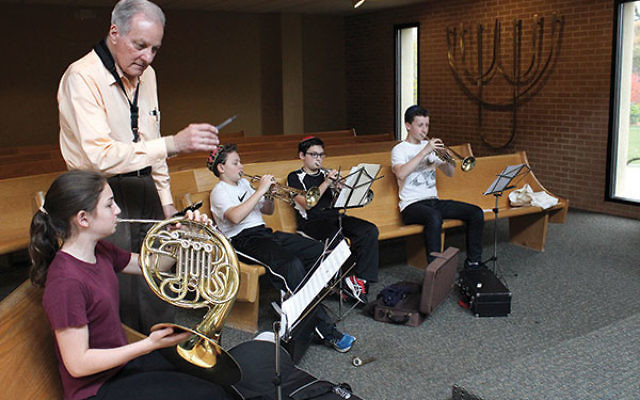 GOA students practice for their Nov. 16 performance with the NJSO musicians with music teacher Richard Perini.
