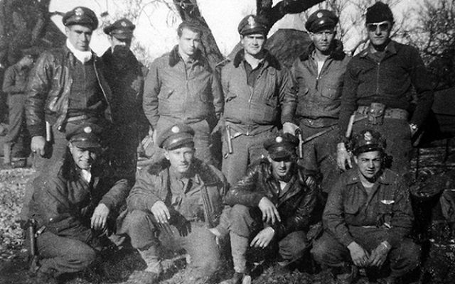 Harold Ginsberg, standing, far left, with other members of his crew in the 451st Bombardment Group (H) of the 15th Air Force during World War II in Europe.