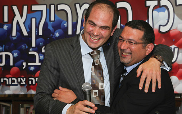 Murad Aliyan and Eli Beer embrace after receiving the Goldberg Prize for Peace in Jerusalem for their collaborative efforts of creating a coexisting organization in United Hatzalah. Photo courtesy United Hatzalah