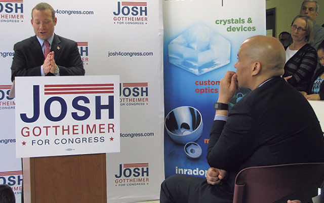 Sen. Cory Booker, right, looks on as fellow Democrat Josh Gottheimer announces his candidacy against Republican Scott Garrett in New Jersey's Fifth Congressional District, Feb. 8.