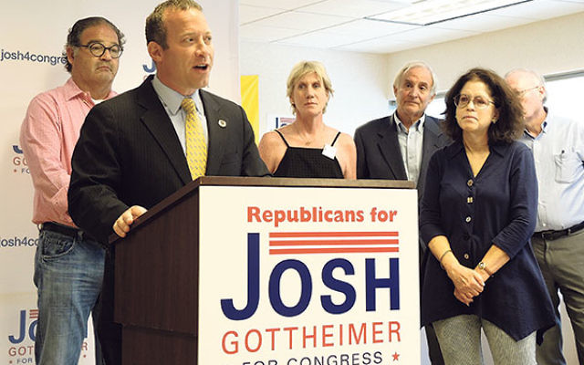 Democrat Josh Gottheimer speaks at a Republicans for Josh rally in Paramus.
