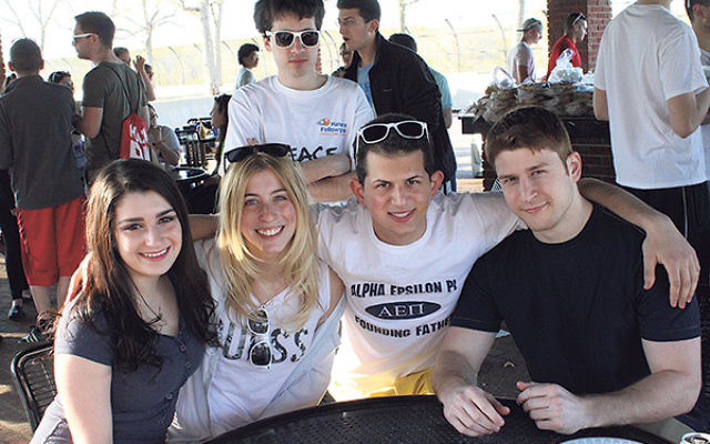Students from Rutgers' AEPi Jewish fraternity and Rutgers Jewish Xperience join together in a barbecue celebrating Israeli Independence Day in spring 2014.