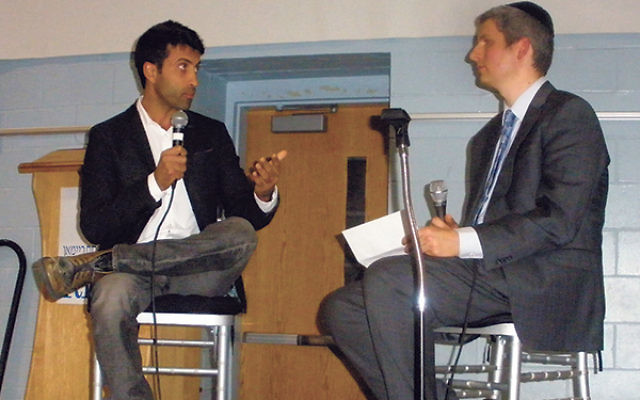 Mosab Hassan Yousef, left, the son of the founder of Hamas who became a counter-spy for Israel, answers questions from Rabbi Steven Miodownik of Congregation Ahavas Achim.