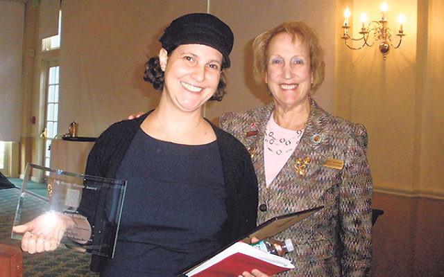 Rabba Sara Hurwitz, left, the first Orthodox woman to be ordained a rabbi, receives Hadassah's annual Myrtle Wreath Award from region president Sherryl Kaufman.
