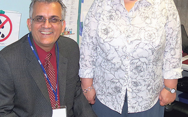 Registered nurse Phyllis Vida and head of school Moshe Vaknin sit in the tiny nurse's office at the Gottesman RTW Hebrew Academy in Randolph. The grant will enable the school's nursing facilities to nearly triple in size when its new building