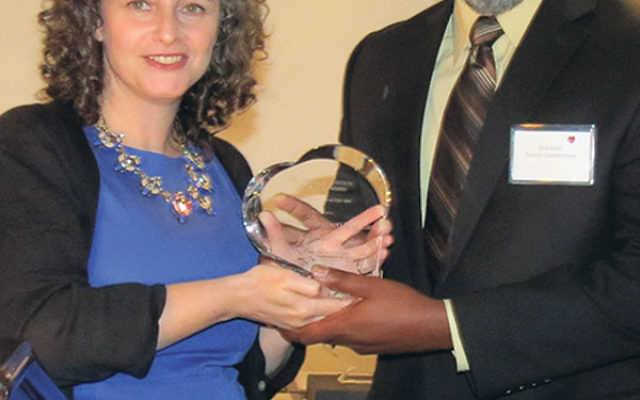 Richard East receives the Healthcare Foundation's Amster Bornstein Veteran's Award from senior program officer Marcy Felsenfeld.