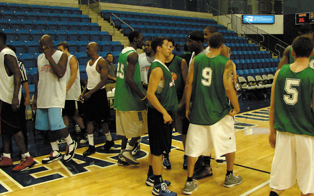 Players exchange good wishes after the second day of the Maccabi Haifa tryouts, held July 20-21 at Nova Southeast University in Ft. Lauderdale. Photos by Ron Kaplan