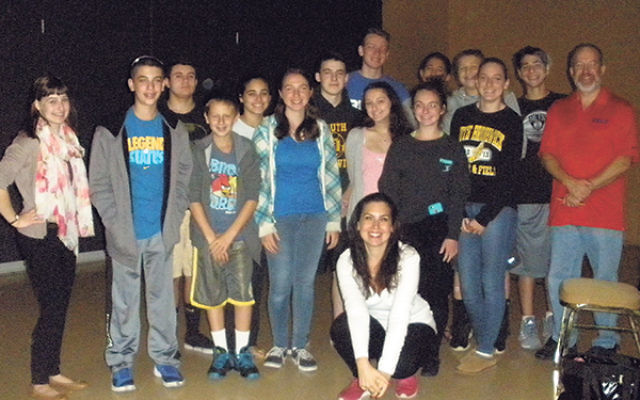 "Vanessa Hidary, the ""Hebrew Mamita,"" kneeling, with Congregation B'nai Tikvah Chai teens and teachers Barry Safeer and Ilana Silverman, far left."