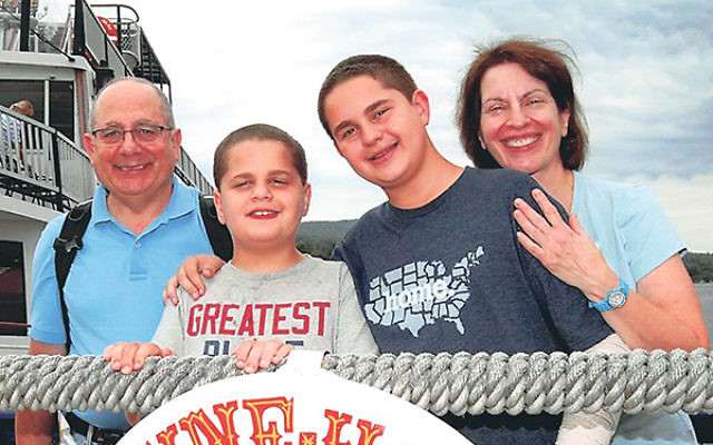 The author, Heidi Rome, with her husband Steven, and two sons, Ethan and Eric.