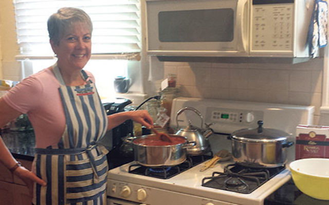 Contest winner Dinah Hendon cooking in her Verona kitchen.