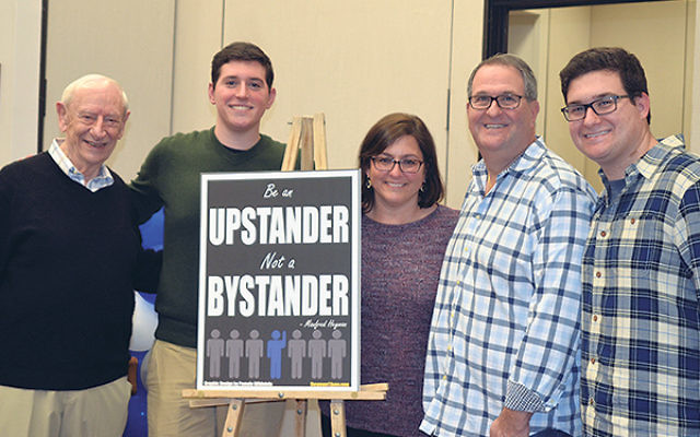 """At the screening of Be An Upstander are, from left, Fred Heyman; Howard Goldberg, Heyman's one-time """"twin"""" who went on to executive produce the film; and his parents, Abby and Joel Goldberg."""