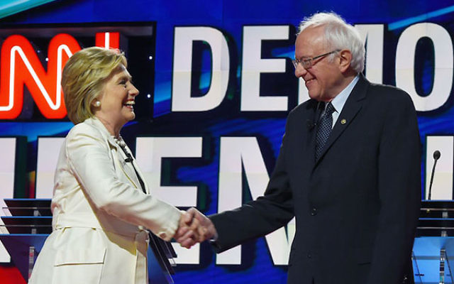 Hillary Clinton, left, and Bernie Sanders shaking hands before the CNN Democratic Presidential Debate at the Brooklyn Navy Yard in New York, April 14, 2016. (Jewel Samad/AFP/Getty Images)
