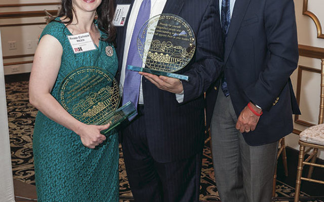 Hillel International president and CEO Eric Fingerhut, right, presented Rutgers Hillel executive director Andrew Getraer and senior associate executive director Rabbi Esther Reed with Visionary in Partnership awards.