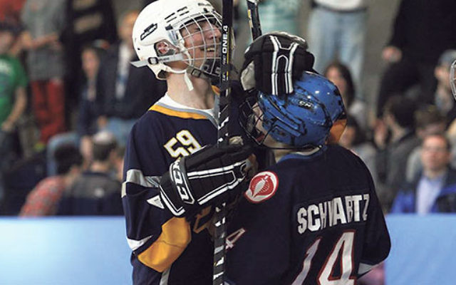 Eli Schwartz, in blue helmet, and Alex Malech, in the white helmet, have organized a hockey tournament on Sept. 21 to benefit an Israeli organization that helps the needy.