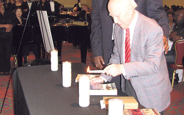 Bob Max, a U.S. Army veteran and prisoner of war who escaped from a Nazi labor camp, served as keynote speaker at Newark's 28th annual Holocaust Remembrance Day luncheon. He was among 12 people, including concentration camp survivors and dignitaries