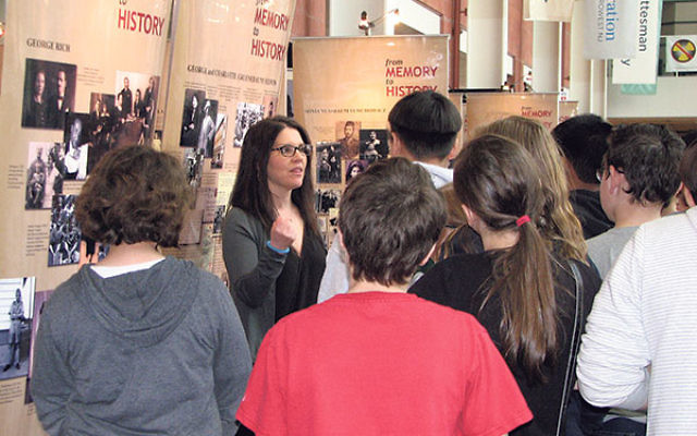 """Sixth-graders from Lazar Middle School in Montville viewing the """"From Memory to History"""" exhibit."""