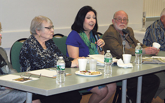Holocaust survivors, from left, Olga Menczek, Gina Lanceter, Peter Engler, and Carl Dubovy shared their stories of liberation as Barbara Wind, center, director of the Holocaust Council of Greater MetroWest, moderated the program.