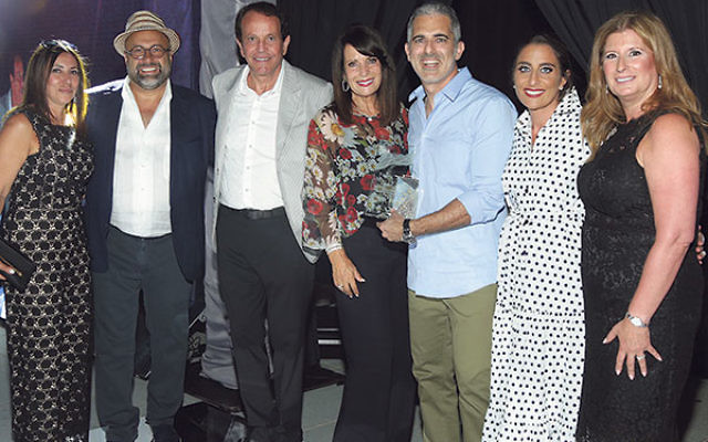 """At the """"Evening of Inspiration"""" are chairs and honorees, from left, Samantha Harary, Harry Adjmi, Charles Ben-Dayan, Ariela Ben-Dayan, Jody and Adele Laboz, and Lisa Oved."""