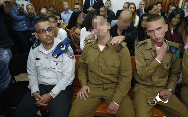 The Israeli soldier who shot a Palestinian attacker in Hebron at a hearing at a military court near Kiryat Malachi, March 29, 2016. (Pool/Flash90)