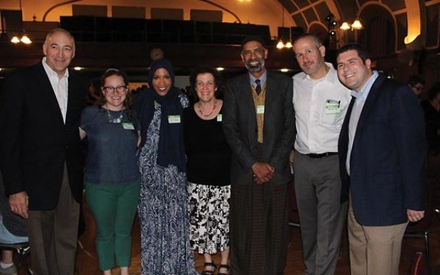 Attendees at the interfaith iftar include, from left, Rabbi Mark Cooper, Rabbi Alexandra Klein, Olympic fencer Ibtihaj Muhammad, Cantor Rikki Lippitz, Ashraf Natif, Rabbi Dan Cohen, and Rabbi Jesse Olitzky. Photo by Lisa Tilton Levine