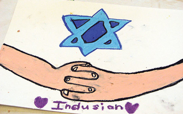 One student at Temple Sharey Tefilo-Israel conveyed the concept of inclusion through clasped hands.