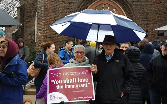 Steve and Judy Richman of the Highland Park Minyan stand outside the Highland Park Reformed Church to support congregants shielding undocumented Indonesian immigrants. Photo courtesy Judy Richman