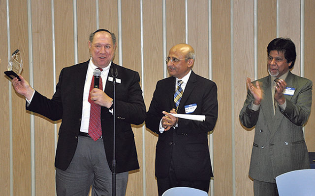 Welcoming guests to Congregation Beth Chaim with Rabbi Eric Wisnia, left, were Tahir Zafar, center, chair of the Institute of Islamic Studies mosque, and mosque founder Shafiq Ahmad.