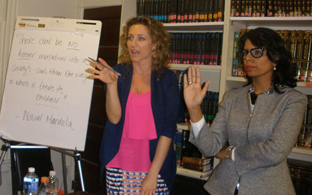 Human rights lawyer Brooke Goldstein, left, and physician Dr. Qanta Ahme, attempt to reason with students gathered at Rutgers Hillel. The pair spoke about the abuse of women and children in the radicalized Muslim world.