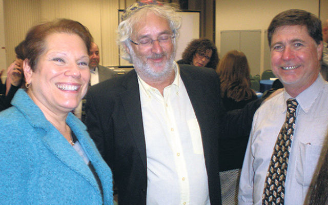 Rabbi Esteban Gottfried, center, leader of Beit T'fila Israeli, joins Rabbi Amy Small and Amir Shacham, the GMW federation's associate executive vice president, Israel and Overseas, at the Israel Center gathering on Nov. 5.