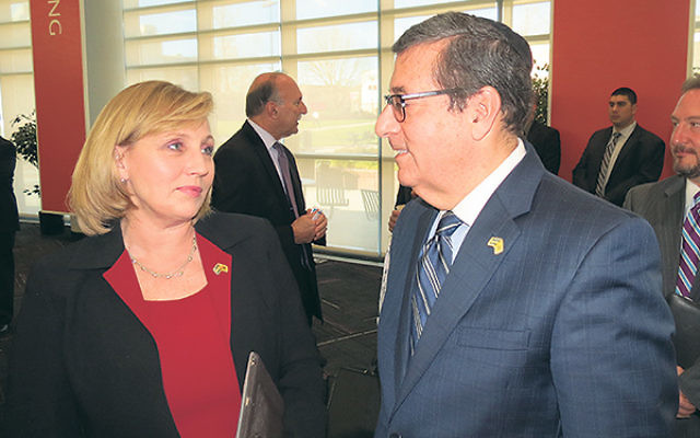 Mark Levenson, chair of the New Jersey-Israel Commission, chatting with Lt. Gov. Kim Guadagno prior to the meeting at NJIT.