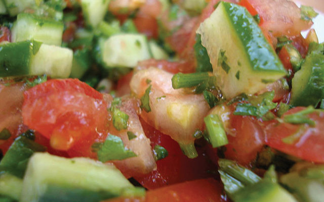 An Israeli salad should be freshly chopped and simply dressed with lemon juice and olive oil. Via Wikimedia
