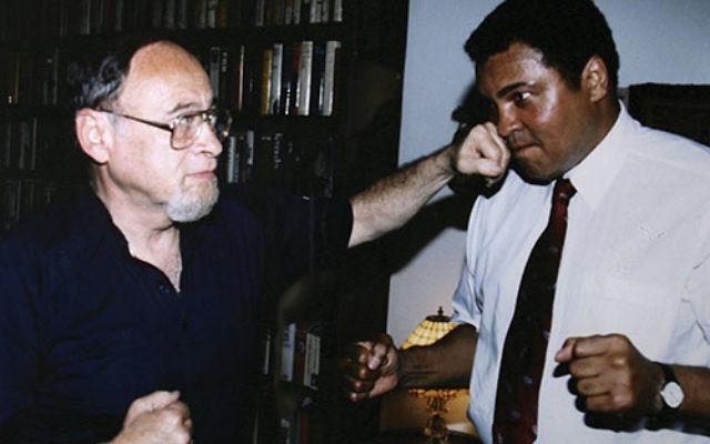 "Jerry Izenberg scores a ""knockout"" punch against heavyweight champion Muhammad Ali. Photo courtesy Jerry Izenberg"