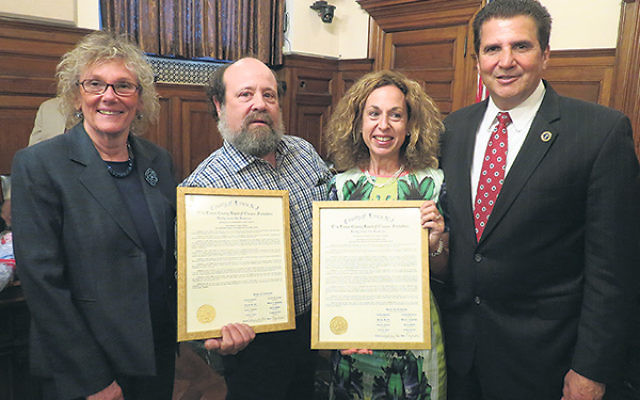 Documentarians Curt Fissel and Ellen Friedland, center, receive citations from Freeholder Pat Sebold and Essex County Executive Joseph DiVincenzo at a May 20 celebration of the county government's Jewish Heritage Month.