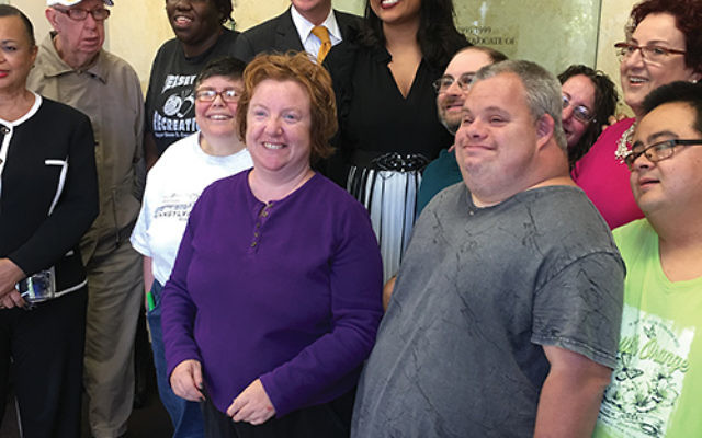 Democratic candidate for NJ governor Phil Murphy with JESPY House clients, Essex County freeholder president Britnee Timberlake, and JESPY director Audrey Winkler, far right. Photos by Johanna Ginsberg