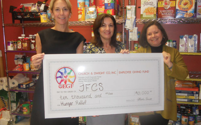 At the presentation of the $10,000 grant are, from left, JFCS executive director Michelle Napell, Amy Solomon from the Church & Dwight Employee Giving Fund, and JFCS board president Audrey Wisotsky.
