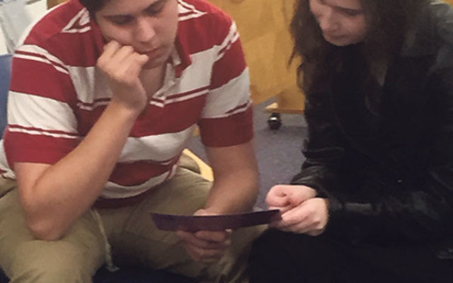 Joe Amster and Estee Wagner of Rae Kushner Yeshiva High School discuss peer counseling at the Jewish Family Service of MetroWest's In Their Shoes training session.