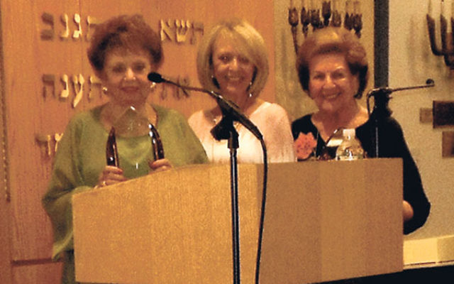 Barbara Polifka, left, and Leona Solomon, right, received awards in recognition of their 19 years of volunteer service to the Jewish Family and Vocational Service of Middlesex County from former JFVS president Vickie Solomon.