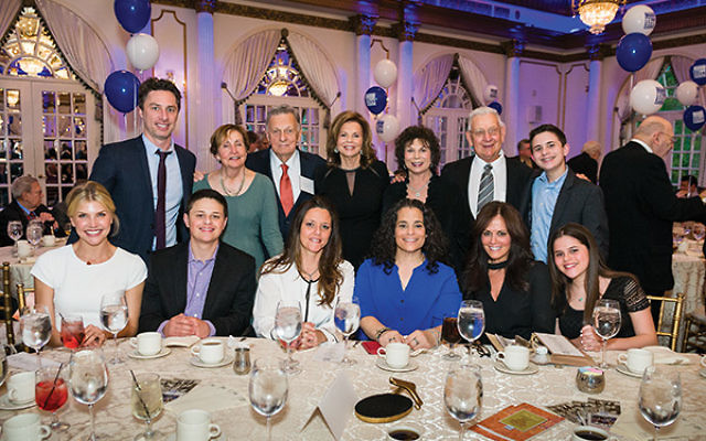 Hal Braff, top row, third from left, is flanked by his family at the Jewish Historical Society's 2017 Lasting Impressions Award dinner. Back row, from left, Zach Braff, Susan Sayers, Elaine Braff, Sheila Rothman, Larry Rothman, and Tyler Gelman. Fro
