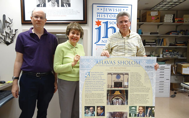 Displaying an exhibit panel on Ahavas Sholom, Newark's oldest functioning synagogue, are, from left, Max Herman, Linda Forgosh, and Phil Yourish. Photos by Robert Wiener