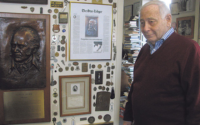 Donald Karp in his office, where the walls are covered with photos of Newark and city memorabilia.