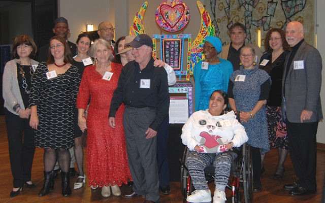 "At the Wae Center's 10th anniversary dinner in November 2014, founder and director Marilynn Schneider, third from left, with the lead artists nd some of their Wae co-creators of the ""Chairs of Inclusion."""