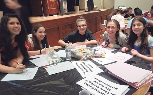 Teens make placements for the West Point Military Academy Jewish Chapel during J-Serve.